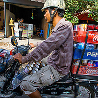 Jan 3, 2013 - Goods of all sorts are transported by two wheels. Here  paint cans are driven to customers in the Cambodian capital city of Phnom Penh.<br /> <br /> Story Summary: Amidst the feverish pace of Phnom Penh&rsquo; city streets, a workhorse of transportation for people and goods emerges: Bicycles, motorcycles, scooters, Mopeds, motodups and Tuk Tuks roam in place of cars and trucks. Almost 90 percent of the vehicles roaming the Cambodian capital of almost 2.3 million people choose these for getting about. Congestion and environment both benefit from the small size and small engines. Business is booming in the movement of goods and and another one million annual tourists in Cambodia&rsquo;s moto culture.