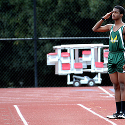 Blair's Michael Anthony salutes during the national anthem prior to the long jump during the Rio Hondo League track and field finals at South Pasadena High School in South Pasadena, Calif., Friday, May 8, 2015. Anthony is a ROTC student at Blair High School.
