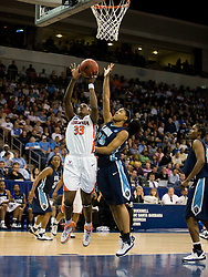 Virginia center Aisha Mohammed (33) shoots a layup past Old Dominion forward Sierra Little (25).  The #11 ranked / #5 seed Old Dominion Lady Monarchs defeated the #24 ranked / #4 seed Virginia Cavaliers 88-85 in overtime in the second round of the 2008 NCAA Women's Basketball Championship at the Ted Constant Convocation Center in Norfolk, VA on March 25, 2008.