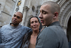 © licensed to London News Pictures. London, UK 29/11/2012. John Kafunda (left) and Reece Donovan (right) who were jailed for robbing a Malaysian student as they pretended to help him during the riots in London, talking to the media outside the Royal Courts of Justice after being released on 29/11/12.  Photo credit: Tolga Akmen/LNP