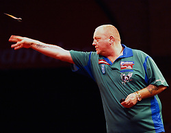 England's Andy Hamilton on his way to beat Vincent van der Voort of the Netherland's, right, 4-3 to move to the next round in the Darts World Championships at Alexandra Palace, London, Tuesday, Dec.. 27, 2011. photo by morn/I-Images