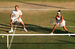 Heather Watson and Henri Kontinen during their mixed doubles match against Ivan Dodig and Sania Mirza on day Nine of the Wimbledon Championships at The All England Lawn Tennis and Croquet Club, Wimbledon.