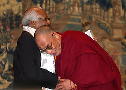 BRUSSELS, BELGIUM - JUNE-01-2006 - Tibetan spiritual leader, the Dalai Lama presents South African Nobel Laureate Archbishop Desmond Tutu with the International Campaign for Tibet's Light of Truth Award at a ceremony in Brussels June 1, 2006.(PHOTO © JOCK FISTICK)