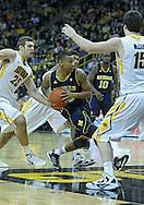 January 14, 2011: Michigan Wolverines guard Trey Burke (3) drives in during the NCAA basketball game between the Michigan Wolverines and the Iowa Hawkeyes at Carver-Hawkeye Arena in Iowa City, Iowa on Saturday, January 14, 2011. Iowa defeated Michigan 75-59.