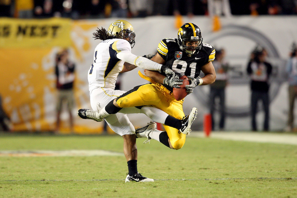 Jan 5, 2010; Miami, FL, USA; Iowa Hawkeyes tight end Tony Moeaki (81) makes a reception as Georgia Tech Yellow Jackets safety Morgan Burnett (1) defends during the third quarter of the 2010 Orange Bowl at Land Shark Stadium. Iowa defeated Georgia Tech 24-14.