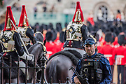 Armed Police Guarding the Guards - Colonel's Review 2018, the last formal inspection of the Household Division before The Queen's Birthday Parade, more popularly known as Trooping the Colour. The Coldstream Guards Troop Their Colour and their Regimental Colonel, Lieutenant General Sir James Jeffrey Corfield Bucknall, takes the salute.