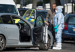 © Licensed to London News Pictures. 13/04/2019. London, UK. Police forensics examine a damaged car at the scene in Holland Park after shots were fired near the Ukrainian embassy. Photo credit: Ben Cawthra/LNP