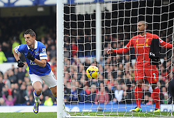 Everton's Kevin Mirallas scores a goal. - Photo mandatory by-line: Dougie Allward/JMP - Tel: Mobile: 07966 386802 23/11/2013 - SPORT - Football - Liverpool - Merseyside derby - Goodison Park - Everton v Liverpool - Barclays Premier League