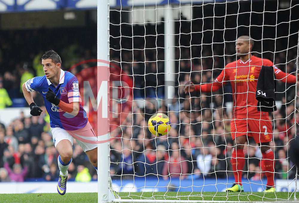 Everton's Kevin Mirallas scores a goal. - Photo mandatory by-line: Dougie Allward/JMP - Tel: Mobile: 07966 386802 23/11/2013 - SPORT - Football - Liverpool - Merseyside derby - Goodison Park - Everton v Liverpool - Barclays Premier League