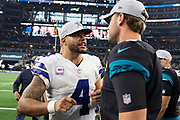 ARLINGTON, TX - OCTOBER 14:  Dak Prescott #4 of the Dallas Cowboys talks of the field after the game with Logan Cooke #9 of the Jacksonville Jaguars at AT&T Stadium on October 14, 2018 in Arlington, Texas.  The Cowboys defeated the Jaguars 40-7.  (Photo by Wesley Hitt/Getty Images) *** Local Caption *** Dak Prescott; Logan Cooke