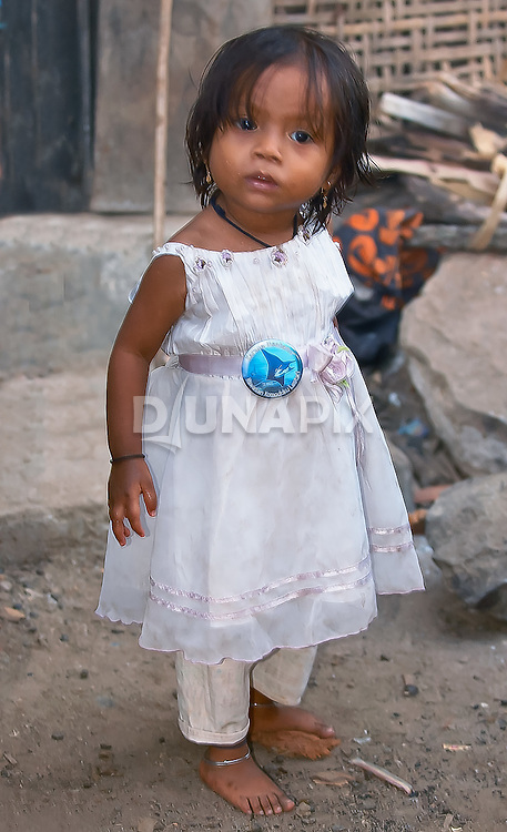 Cure young girl with RARE Pride button, Komodo Village, Komodo National Park