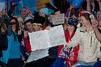 Australians and other and visitors fill Village Square in Whistler, BC for the 2010 Winter Olympic Games opening ceremony broadcast from Vancouver.