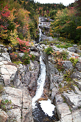 A long waterfall called the Silver Cascade plunges down a rocky Mt. Jackson cliff along state highway 302 south of HIghland Center, New Hampshire
