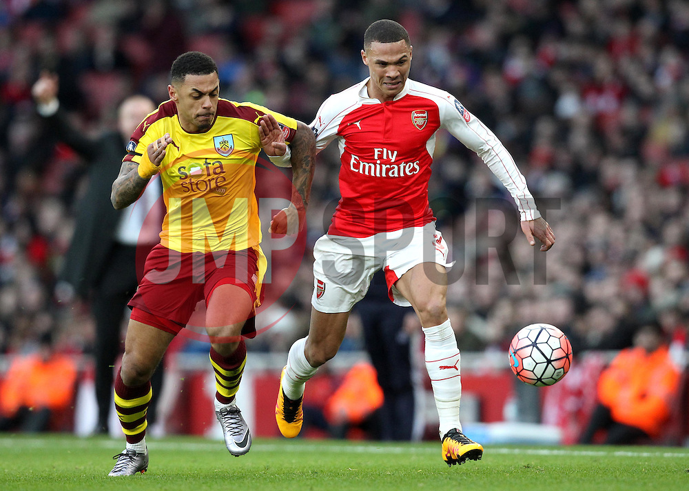 Kieran Gibbs of Arsenal battles with Andre Gray of Burnley - Mandatory byline: Robbie Stephenson/JMP - 30/01/2016 - FOOTBALL - Emirates Stadium - London, England - Arsenal v Burnley - FA Cup Forth Round