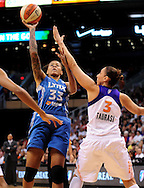 Sep 25, 2011; Phoenix, AZ, USA; Minnesota Lynx guard Seimone Augustus (33) puts up a shot against Phoenix Mercury guard Diana Taurasi (3) during the first half at the US Airways Center. Mandatory Credit: Jennifer Stewart-US PRESSWIRE