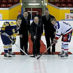 WHITBY, ON - Nov 27 : Ontario Junior Hockey League International Exhibition, between the Whitby Fury and the visiting Adler Mannheim from Germany. Team Adler Mannheim representative drops the puck for the ceremonial face-off with both Team Captains accompanied by OJHL Commissioner Marty Savoy and OHA President Scott Farley. <br /> (Photo by Tim Bates / OJHL Images)