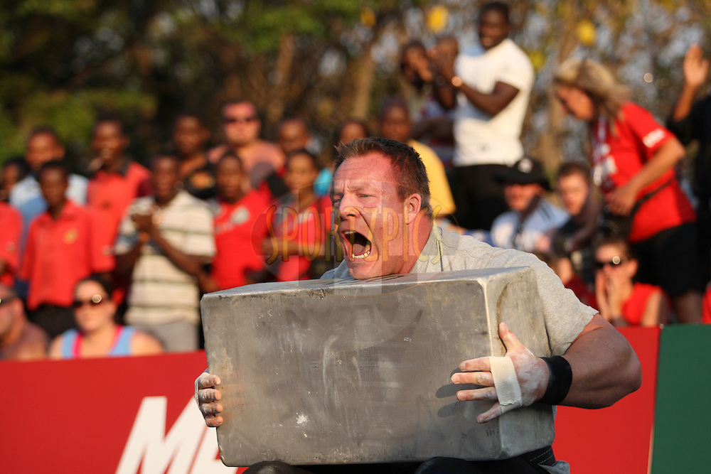 Richard Skog (Norway) summons all his strength to lift a 150kg metal block during one of the qualifying rounds of the World's Strongest Man competition held in Sun City, South Africa.