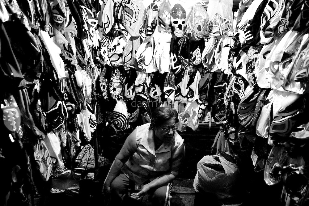Woman selling Luchador masks outside  of the Luchador arena, Mexico City, Mexico