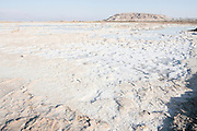 Israel, Dead Sea salt formation caused by the evaporation of the water.