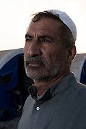 Iraq, Qayyara: Mahmood, displaced from Tob Zawa is portrait in Alkazik camp. Alessio Romenzi