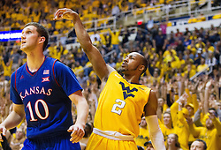 Jan 24, 2017; Morgantown, WV, USA; West Virginia Mountaineers guard Jevon Carter (2) shoots a three pointer over Kansas Jayhawks guard Sviatoslav Mykhailiuk (10) during the second half against the Kansas Jayhawks at WVU Coliseum. Mandatory Credit: Ben Queen-USA TODAY Sports