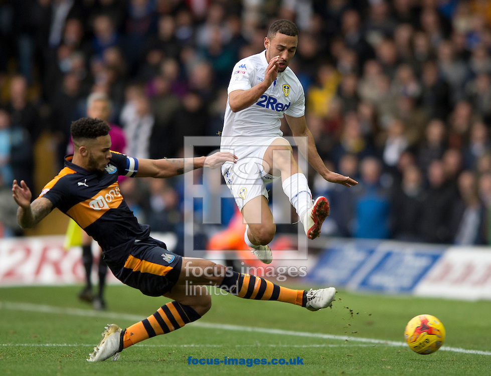 Kemar Roofe of Leeds United (right) evades a challenge by Jamaal Lascelles of Newcastle United during the Sky Bet Championship match at Elland Road, Leeds<br /> Picture by Russell Hart/Focus Images Ltd 07791 688 420<br /> 20/11/2016