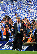 Chelsea Manager Guus Hiddink watches anxiously from the sideline during the UEFA Champions League Quarter Final Second Leg match between Chelsea and Liverpool at Stamford Bridge on April 14, 2009 in London, England.