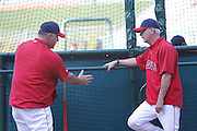 ANAHEIM, CA - JUNE 06:  Mike Scioscia (14) of the Los Angeles Angels of Anaheim and batting coach Jim Eppard (80) of the Angels (right) talks batting technique as they watch batting practice before the game against the Seattle Mariners on Wednesday, June 6, 2012 at Angel Stadium in Anaheim, California. The Mariners won the game 8-6. (Photo by Paul Spinelli/MLB Photos via Getty Images) *** Local Caption *** Mike Scioscia;Jim Eppard