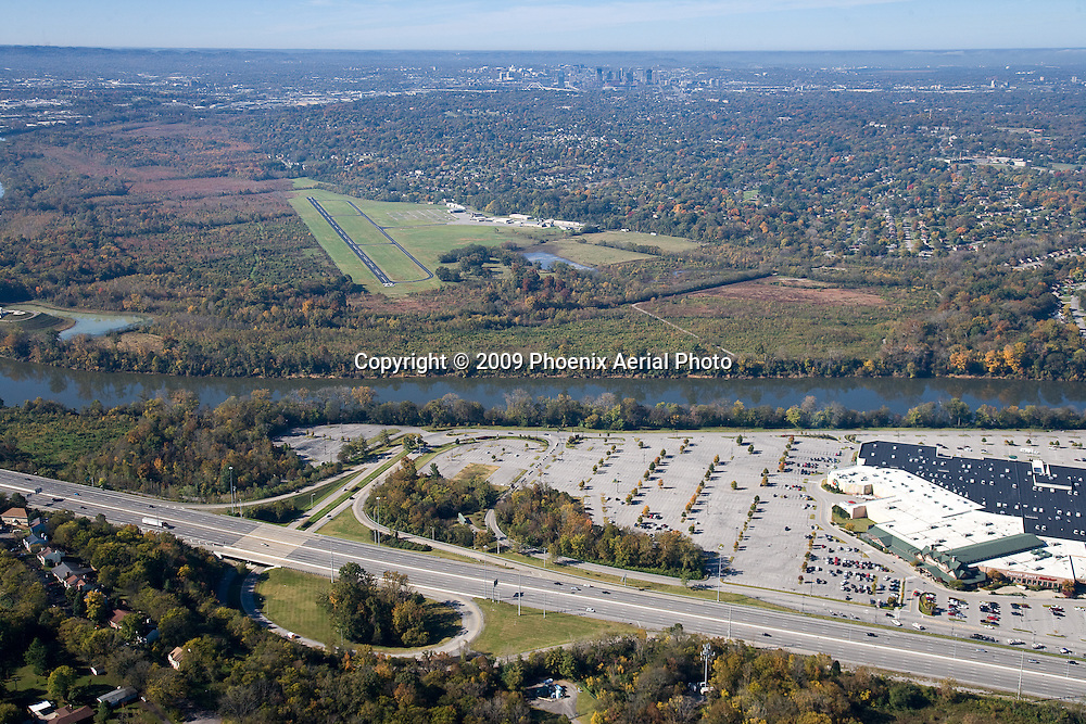 Aerial photo of Cornelia Fort Airpark in Nashville Tennessee showing the Downtown skyline in the background and Briley Parkway in the foreground.