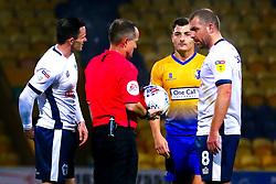 Stephen Dawson of Bury is penalised by the referee - Mandatory by-line: Ryan Crockett/JMP - 04/12/2018 - FOOTBALL - One Call Stadium - Mansfield, England - Mansfield Town v Bury - Checkatrade Trophy