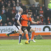 Dundee United&rsquo;s Chris Erskine holds off Dundee&rsquo;s Gary Harkins - Dundee v Dundee United, Ladbrokes Premiership at Dens Park<br /> <br />  - &copy; David Young - www.davidyoungphoto.co.uk - email: davidyoungphoto@gmail.com