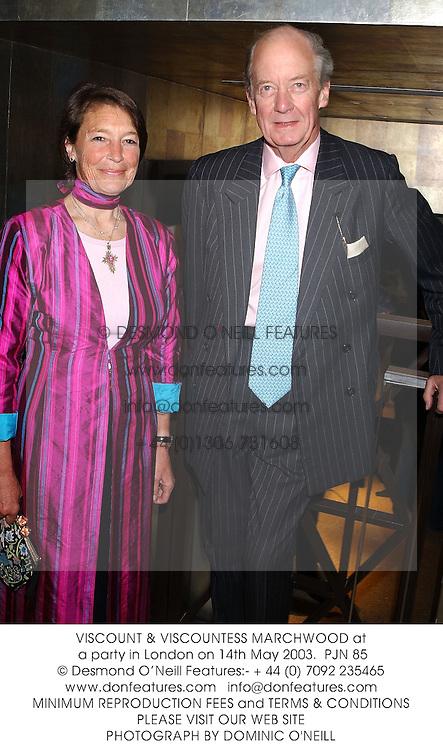 VISCOUNT & VISCOUNTESS MARCHWOOD at a party in London on 14th May 2003.PJN 85