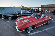 During summer from June to Septemper, every first Friday of the month is Vintage Car Cruising Night. Hundreds of classic American cars cruise around downtown Helsinki and meet at special places to have a good time, here at Kaivopuisto (Brunnsparken). Here a Chevrolet Corvette Sting Ray Convertible.