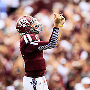 Aug 31, 2013; College Station, TX, USA; Texas A&M Aggies quarterback Johnny Manziel (2) celebrates throwing his first touchdown of the season against the Rice Owls during the third quarter at Kyle Field. Mandatory Credit: Thomas Campbell-USA TODAY Sports