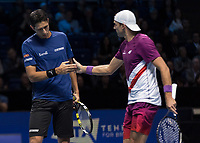 Tennis - 2019 Nitto ATP Finals at The O2 - Day One<br /> <br /> Doubles Group Jonas Bjorkman: Lukasz Kubot (POL) & Marcelo Melo (BRA) Vs. Ivan Dodig (CRO) & Filip Polasek (SVK)<br /> <br /> Marcelo Melo (BRA) and Lukasz Kubot (POL) congratulate each other on taking the point in action at the O2 Arena <br /> <br /> COLORSPORT/DANIEL BEARHAM