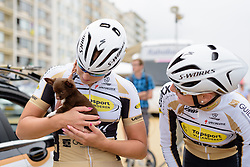 Kelly Druyts and Kelly van den Steen (Topsport Vlaanderen Etixx) make a new friend at the 4.4 km Prologue of the Lotto Belgium Tour 2016 on 6th September 2016 in Nieuwpoort, Belgium. (Photo by Sean Robinson/Velofocus).