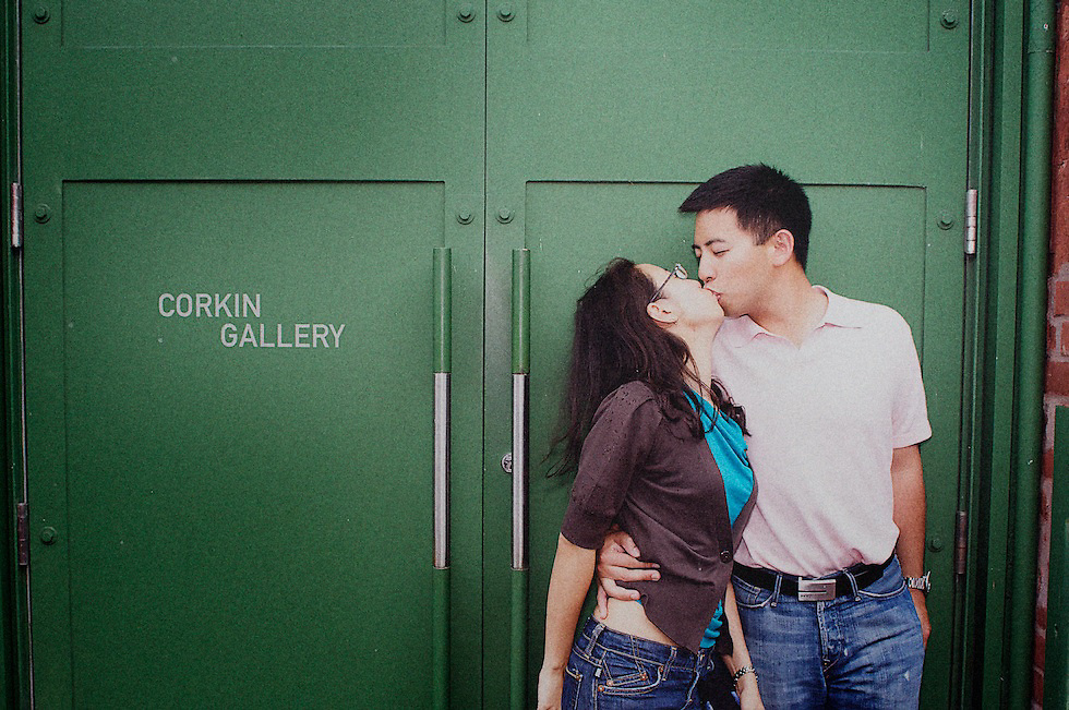 Daphina and Charles share a kiss in front of the Corkin Gallery in Toronto's Distillery District.