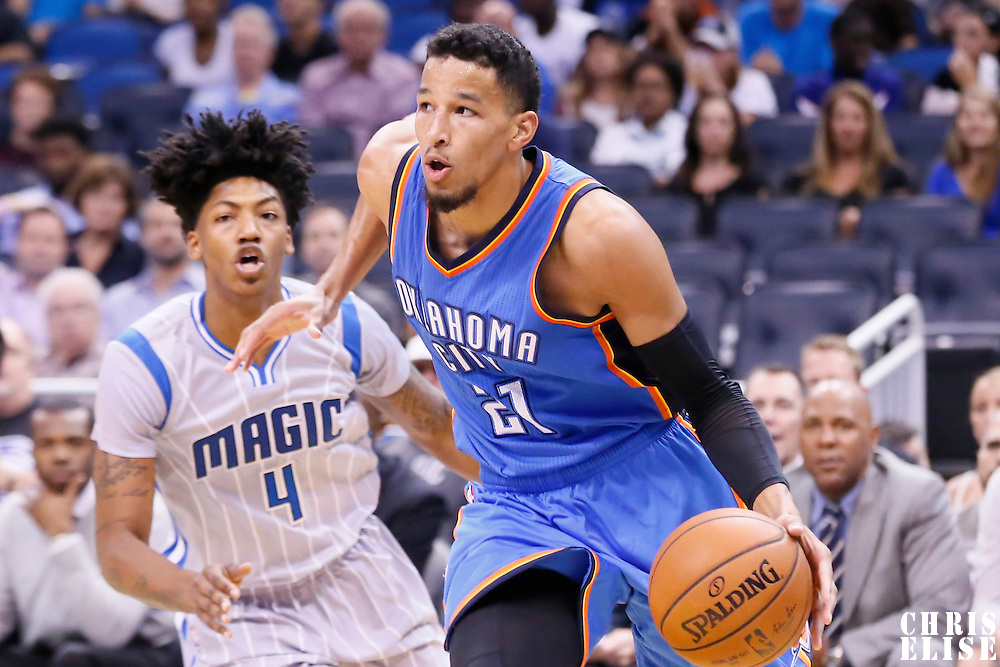 30 October 2015: Oklahoma City Thunder guard Andre Roberson (21) drives past Orlando Magic guard Elfrid Payton (4) during the Oklahoma City Thunder 139-136 double overtime victory over the Orlando Magic, at the Amway Center, in Orlando, Florida, USA.