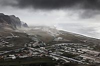 The town of Vík was hit badly by ashfall during the Eyjafjallajökull eruption. View from Reynisfjall over town clearly shows ash blowing around.