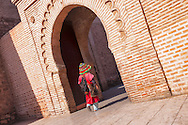 A water-seller in his traditional cloths at the Koutoubia mosque in Marrakech, Morocco.