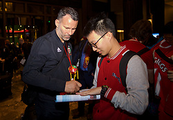 NANNING, CHINA - Monday, March 19, 2018: Wales' manager Ryan Giggs signs an autograph for a supporter as the team arrive at the Wanda Realm Resort in Nanning for the 2018 Gree China Cup International Football Championship. (Pic by David Rawcliffe/Propaganda)