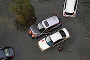 WUHAN, CHINA - JULY 09: <br /> <br /> Vehicles are submerged in floodwaters on July 10, 2016 in Wuhan, Hubei Province of China. Many parts of Wuhan city have been submerged in floodwaters since July 9, due to torrential rains and flood peaks on the Yangtze river. <br /> ©Exclusivepix Media