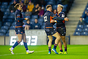 Darcy Graham (#14) of Edinburgh Rugby is congratulated by George Taylor (#12) and Henry Pyrgos (#21) of Edinburgh Rugby after scoring his fourth try during the European Rugby Challenge Cup match between Edinburgh Rugby and SU Agen at BT Murrayfield, Edinburgh, Scotland on 18 January 2020.