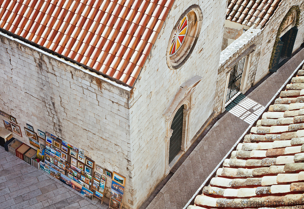 A view from above of a street, buildings and art for sale in the old city of Dubrovnik, Croatia. <br /> <br /> Dubrovnik serves as the official setting of &quot;King's Landing&quot; from the popular TV show &quot;Game of Thrones&quot;.