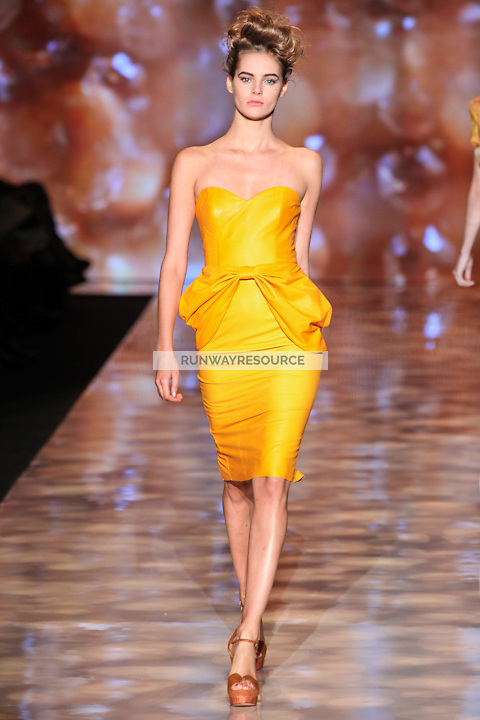 Juju Ivanyuk walks the runway wearing Badgley Mischka Spring 2012 Collection during Mercedes-Benz Fashion Week in New York on September 13, 2011