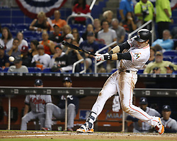 April 10, 2017 - Miami, FL, USA - The Miami Marlins' Christian Yelich hits a single during the third inning against the Atlanta Braves at Marlins Park in Miami on Tuesday, April 11, 2017. (Credit Image: © David Santiago/TNS via ZUMA Wire)