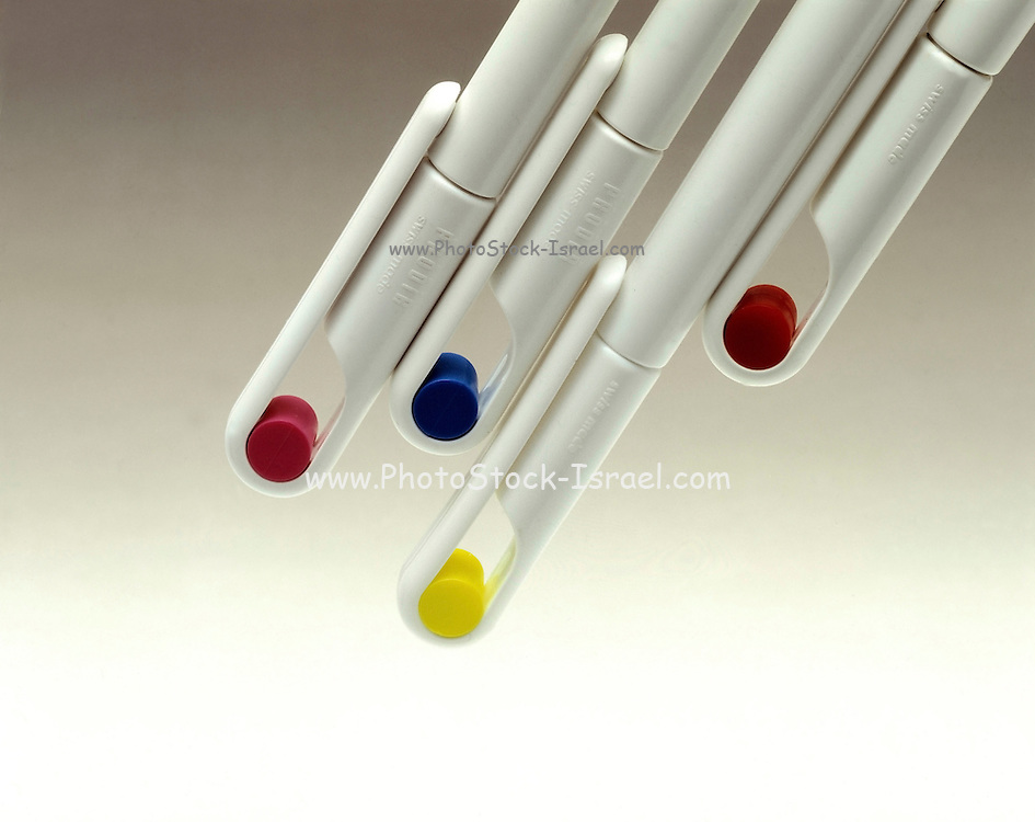 4 pens of different colour on white background