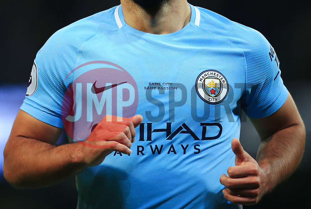 """""""Same City Same Passion"""" is printed on the home jersey of Sergio Aguero of Manchester City following the merge in branding of the club's Mens and Womens first teams - Mandatory by-line: Matt McNulty/JMP - 10/02/2018 - FOOTBALL - Etihad Stadium - Manchester, England - Manchester City v Leicester City - Premier League"""