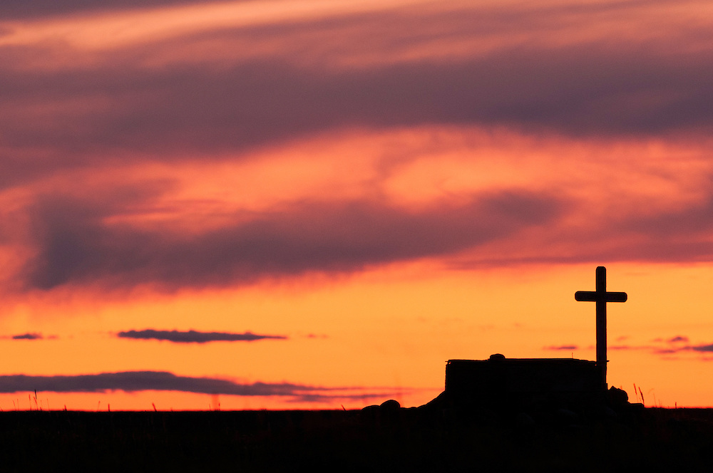 CANADA, Nunavut.Ancient tomb in the tundra at sunset