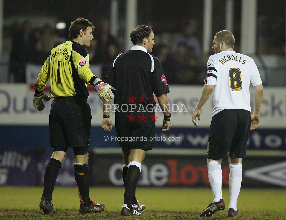 LUTON, ENGLAND - SATURDAY, JANUARY 7th, 2006: Luton Town's Marlon Beresford and Kevin Nicholls complain to referee Mark Clattenburg after conceding a penalty against Liverpool during the FA Cup 3rd Round match at Kenilworth Road. (Pic by David Rawcliffe/Propaganda)